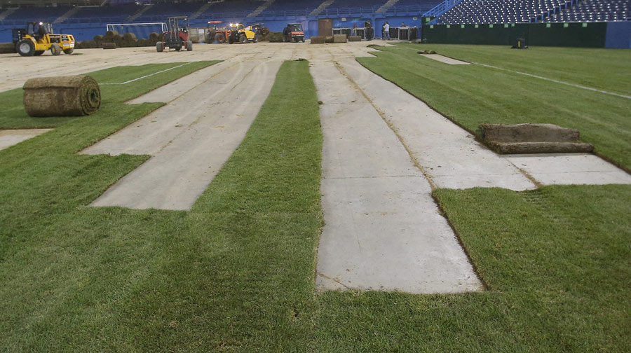 The sod is rolled up and removed following the soccer match between Brazil and Chile on November 19, 2013