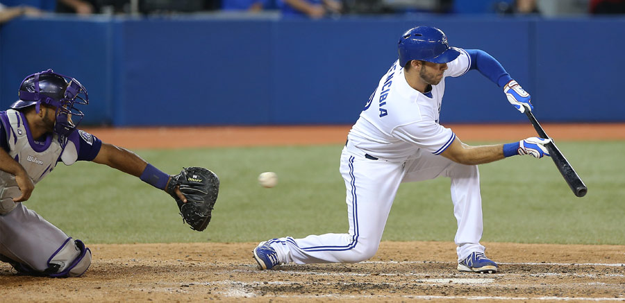 Oops: J.P. Arencibia whiffs on a bunt attempt on June 17, 2013
