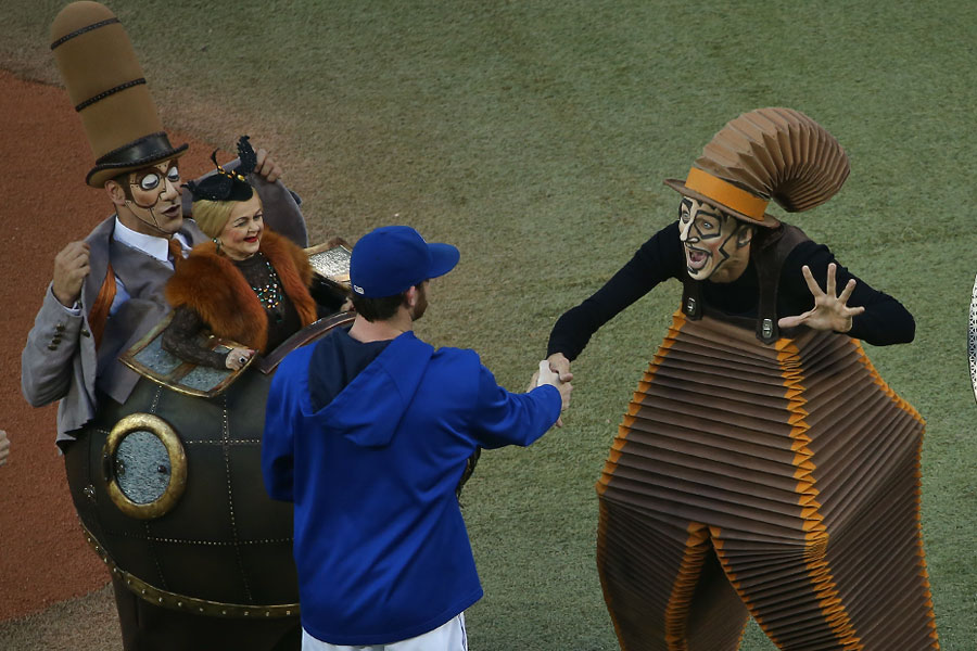 An undoubtedly befuddled Drew Hutchison greets the characters of ?Kurios? ? I wonder what was going through his mind at this precise instant