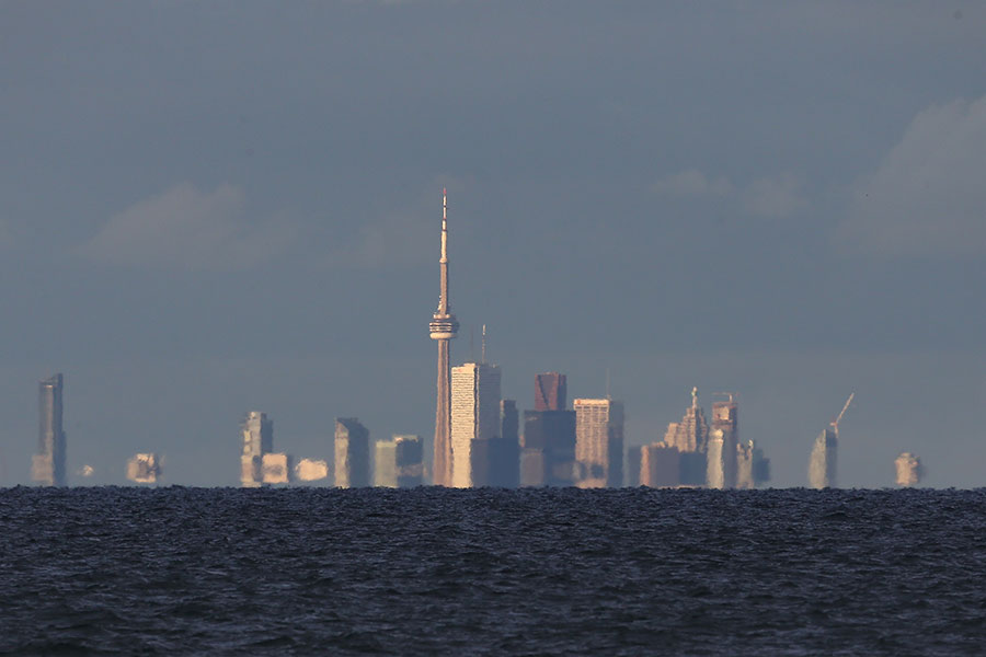 The skyline of Toronto from across the choppy waters of Lake Ontario