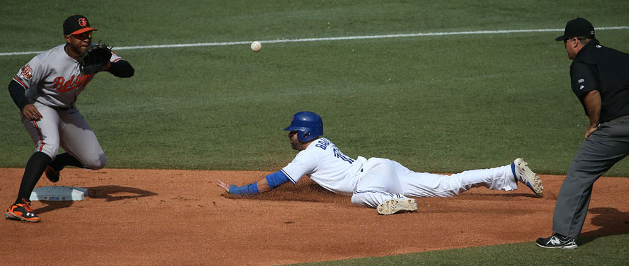 Jose Bautista steals second base as Jonathan Schoop waits for the ball