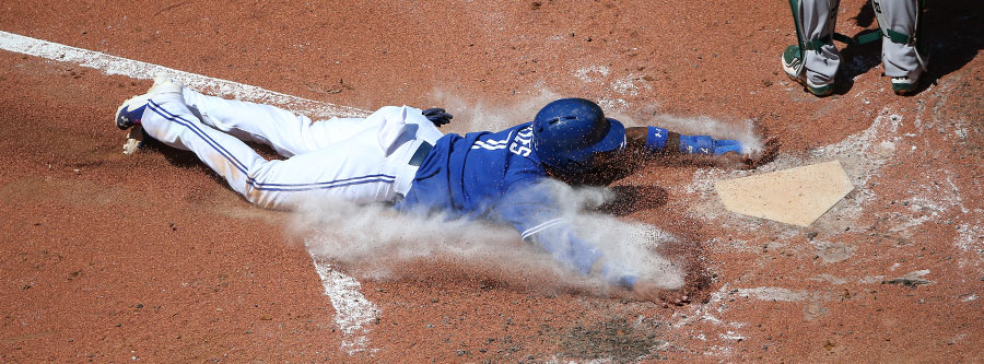 Jose Reyes slides across home plate to score