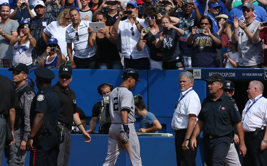 Derek Jeter walks off the Rogers Centre field for the last time after lining out in the 9th inning to end the game