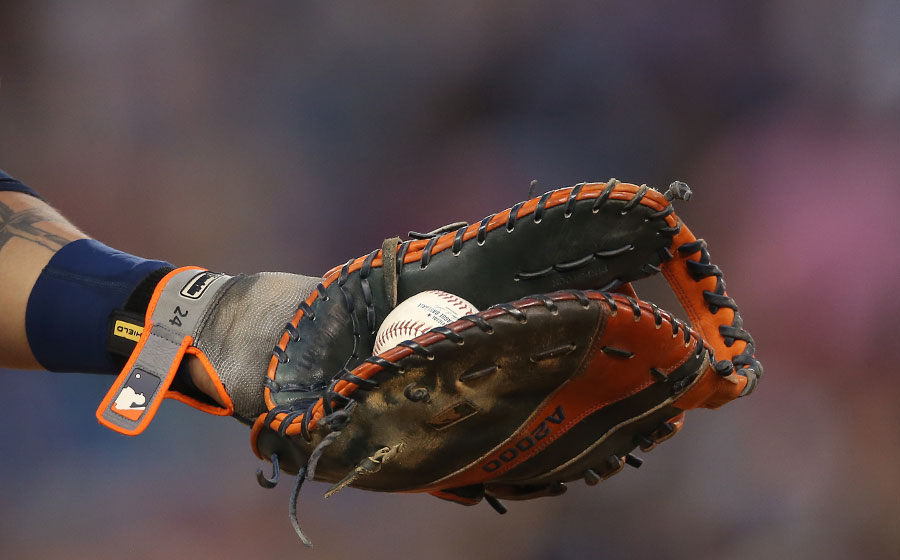 Miguel Cabrera squeezes a baseball in his palm