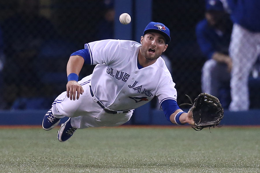 Kevin Pillar of the Toronto Blue Jays dives but cannot get to a double that drops in front of him setting up the tying run in the ninth inning against the Minnesota Twins