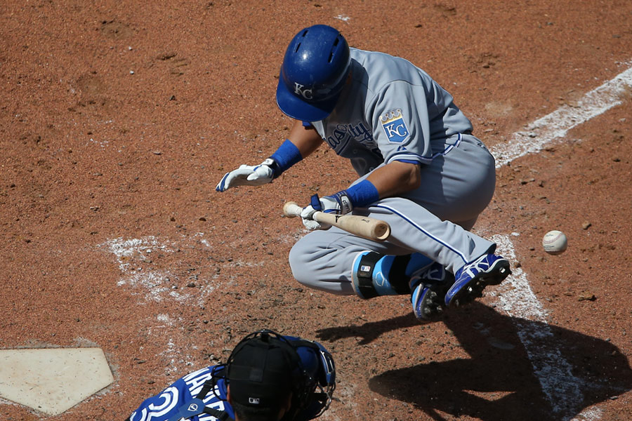 Norichika Aoki of the Kansas City Royals reacts after being hit by a pitch with the bases loaded against the Toronto Blue Jays