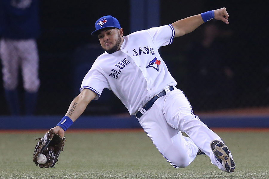 Melky Cabrera of the Toronto Blue Jays slides but cannot hold on to a double hit by Brett Gardner of the New York Yankees
