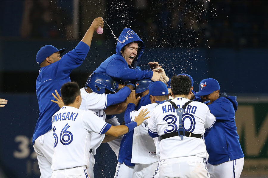 Casey Janssen goes high as the Toronto Blue Jays celebrate their second walk-off victory of the season on June 9th against the Minnesota Twins