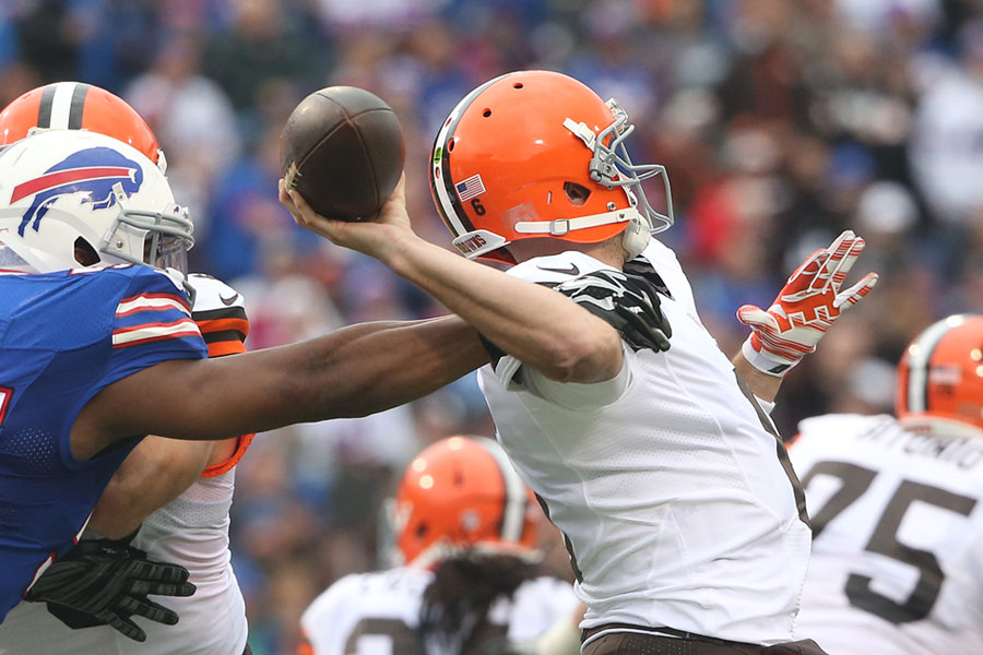 Brian Hoyer of the Cleveland Browns is hit as he throws by the Buffalo Bills' Jerry Hughes