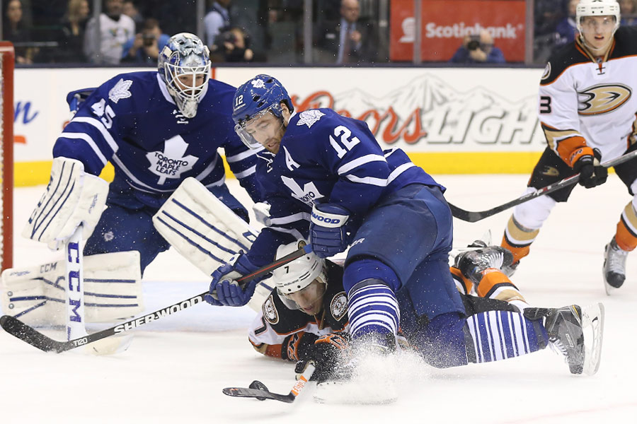 Toronto Maple Leafs defenseman Stephane Robidas defends against Anaheim Ducks center Andrew Cogliano as Cogliano tries to control the puck