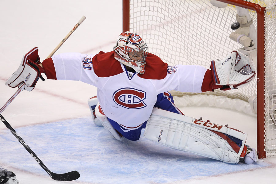 Carey Price stretches but cannot make the save as Mason Raymond(not pictured) beats him for a goal
