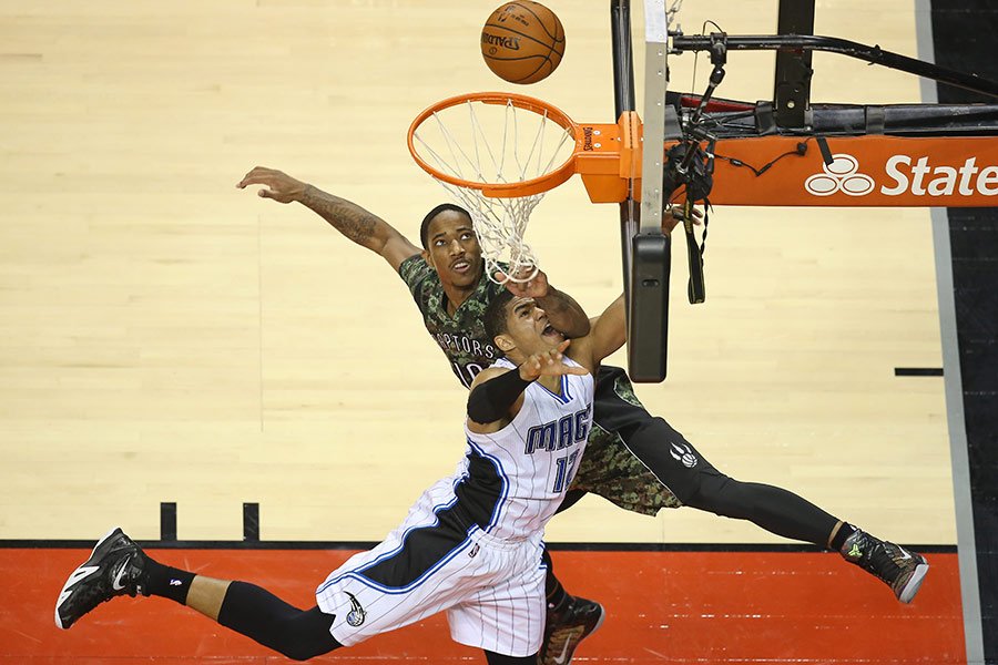 Orlando Magic forward Tobias Harris is fouled by Toronto Raptors guard DeMar DeRozan as he goes up to the hoop