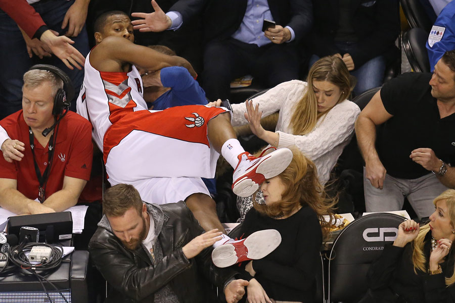 Kyle Lowry of the Toronto Raptors goes into the seats in pursuit of the ball