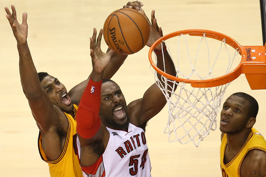 Toronto Raptors forward Patrick Patterson is fouled by Cleveland Cavaliers forward Tristan Thompson as he drives to the basket