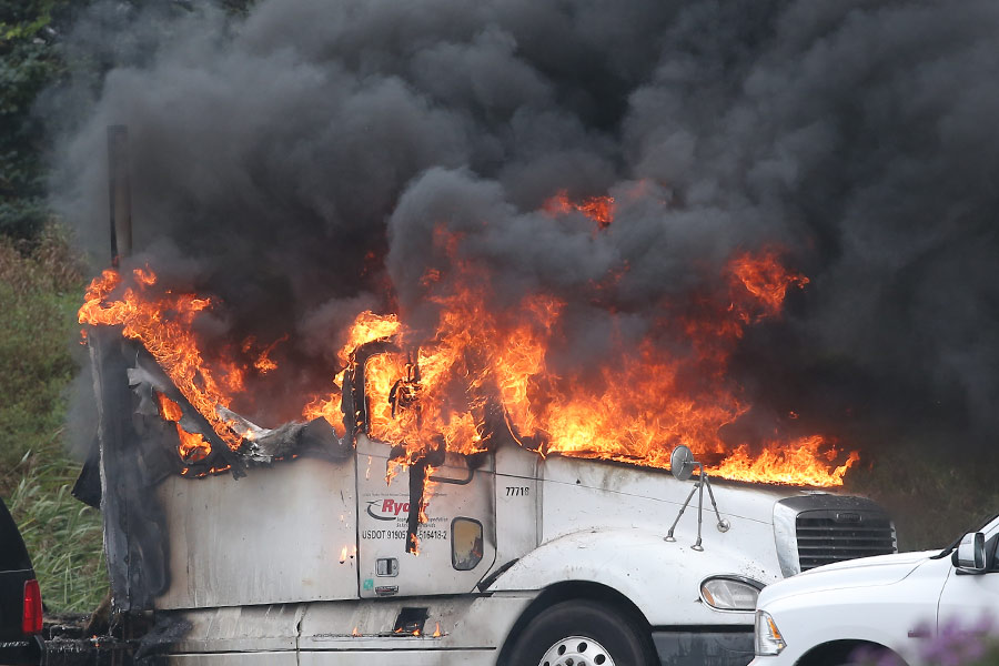 A truck burns on the westbound 401 near Woodstock