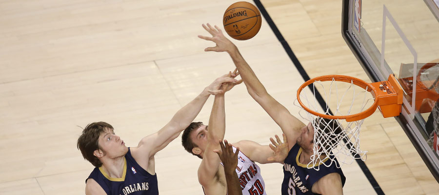 Tyler Hansbrough is blocked on his way to the basket as his and a pair of New Orleans Pelicans? extended arms make a pyramid