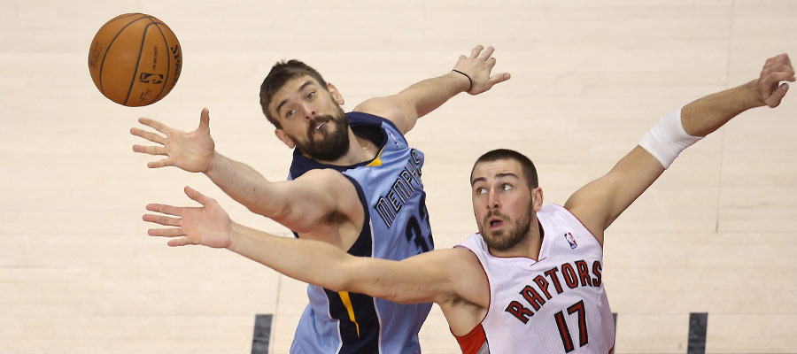 Marc Gasol and Jonas Valanciunas ? and their right arms ? go after a rebound