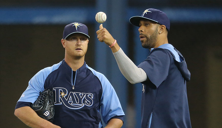 Player-to-player advice: David Price teaches Alex Cobb about how a baseball breaks