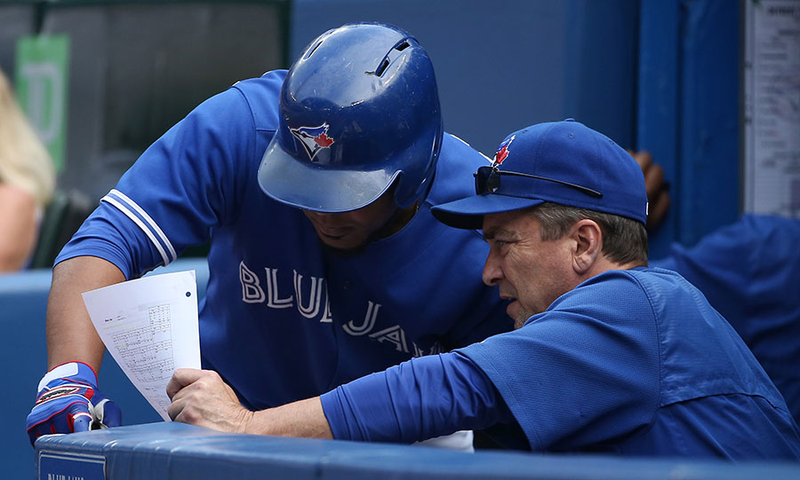 Edwin Encarnacion gets the scouting report from hitting coach Brook Jacoby during a pitching change before hitting a grand slam ? his third homer of the game ? against the Tigers on August 29, 2015