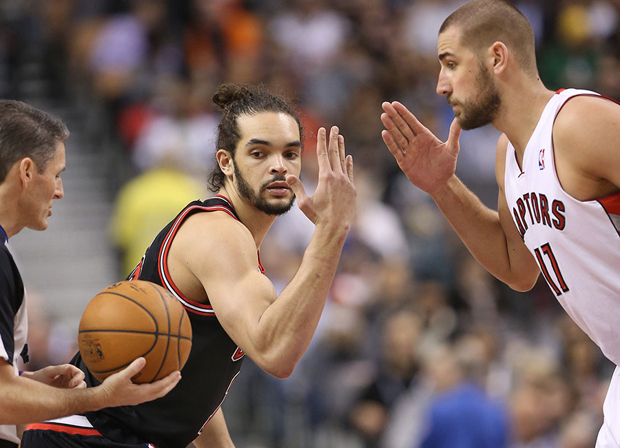 Jump ball :  May the best slice win ? either we?re in for some kind of slicing contest or Joakim Noah and Jonas Valanciunas are about to begin an arm wrestling competition