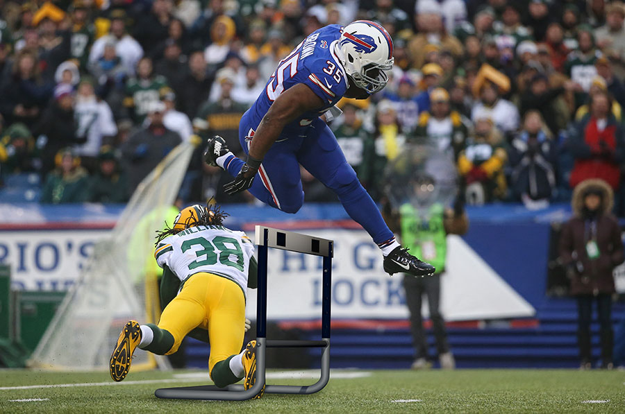 The Gridiron steeplechase :  Bryce Brown hurdles over Tramon Williams of the Packers surely making Edwin Moses quite proud