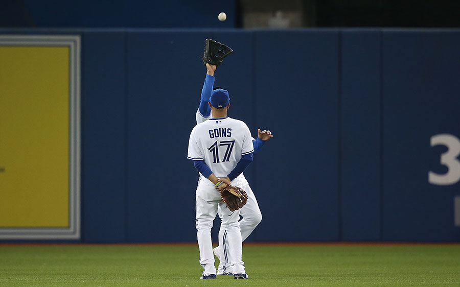 You catch the ball, I?ll just stand here and take the credit, m-m-kay ? :  Ryan Goins gives way to Ezequiel Carrera on a fly ball to right ? Goins could hardly look any less involved in this play unless he started twiddling his thumbs