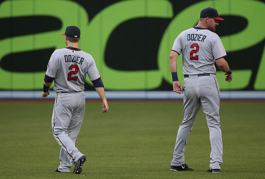 A lab experiment clearly gone awry.  Here, Mike Pelfrey(on the right) ? not a clone of Brian Dozier ? trolls the real Dozier by wearing a duplicate jersey