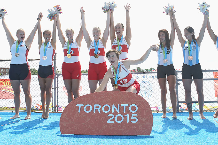 From euphoria to horror: Antje von Seydlitz of Canada holds on to her gold medal but drops her Pan Am Games mascot Pachi as she momentarily interrupts her teammates? celebration on the medal stand after winning in the women?s quadruple sculls to pick up the mishandled toy