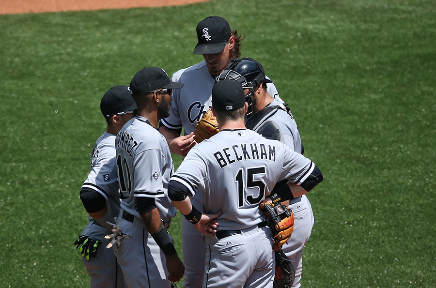 Jeff Samardzija towers over his White Sox teammates during a conference on the mound giving them nary a chance to talk down to him