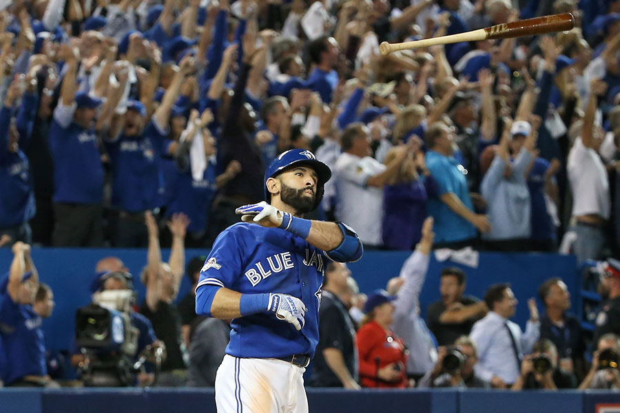 Jose Bautista caber tosses his Marucci lumber after hitting a tie-breaking three-run home run in Game 5 of the ALDS against the Texas Rangers after a contentious seventh inning