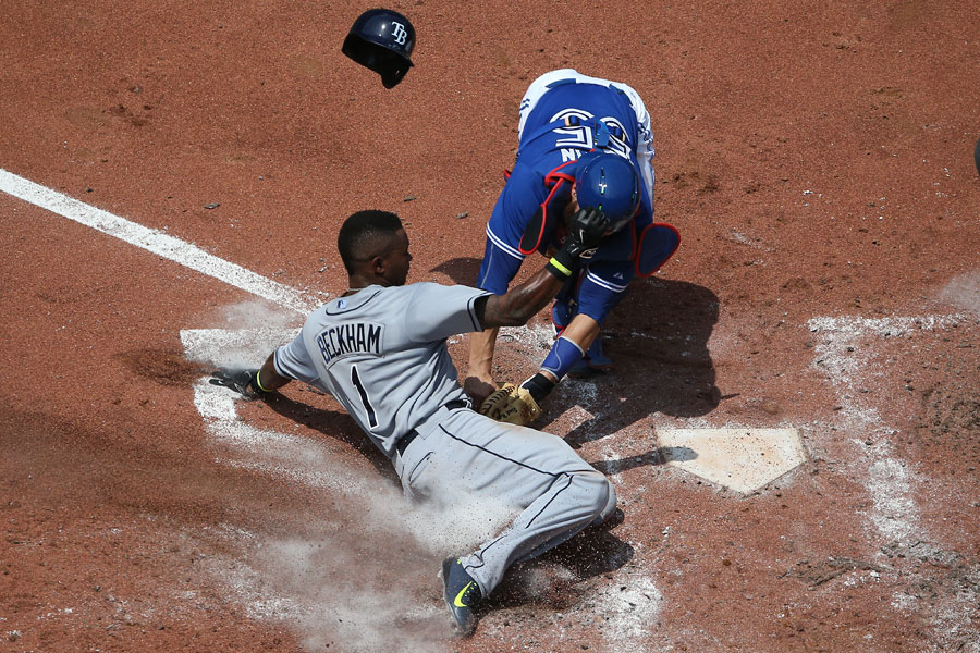 Russell Martin tags out Tim Beckham to cut down a run at home plate