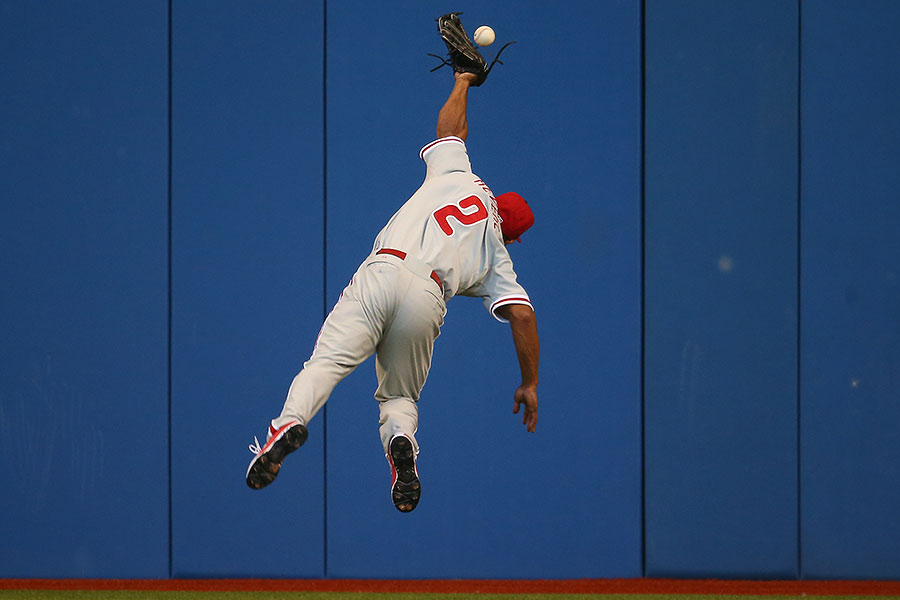 Usually a maestro with the leather, here Ben Revere jumps but cannot squeeze a double hit by Russell Martin. A couple of days later, Revere would be traded from the Phillies to the Blue Jays