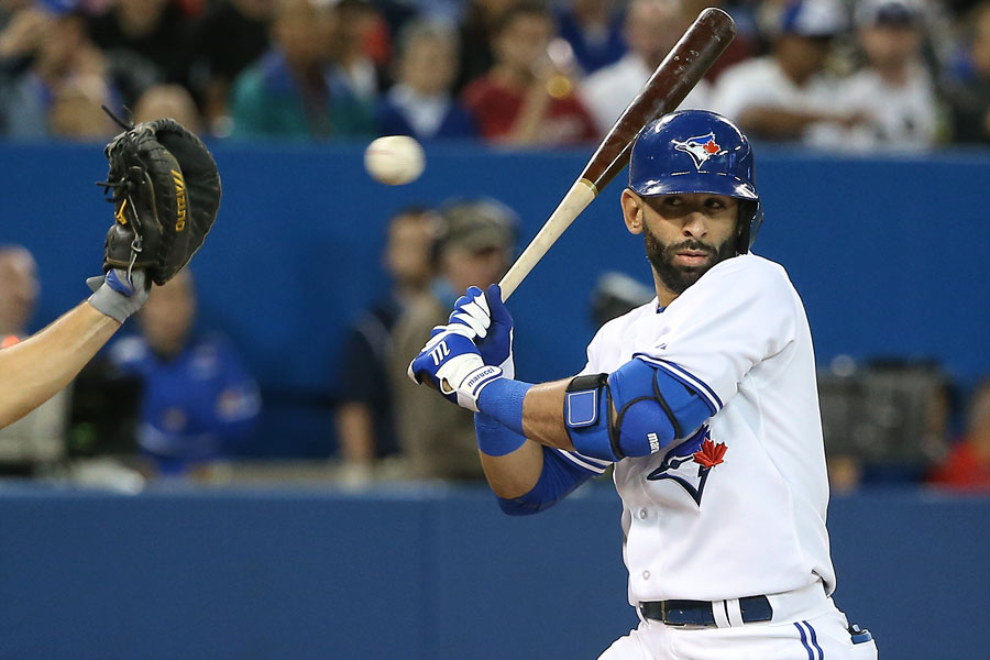 Jose Bautista keeps an eye on a high-and-tight pitch as he gets out of the way