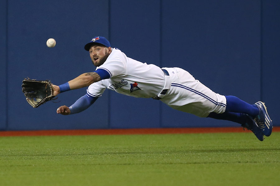 Kevin Pillar, one of the best fielders to ever suit up, gives it his all as he once again dives but comes up short going after an RBI double hit by Danny Valencia