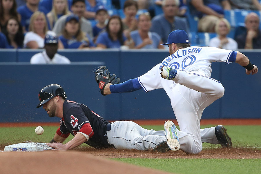 Jason Kipnis advances safely to third base on a fielder?s choice as Josh Donaldson cannot hold on to the ball