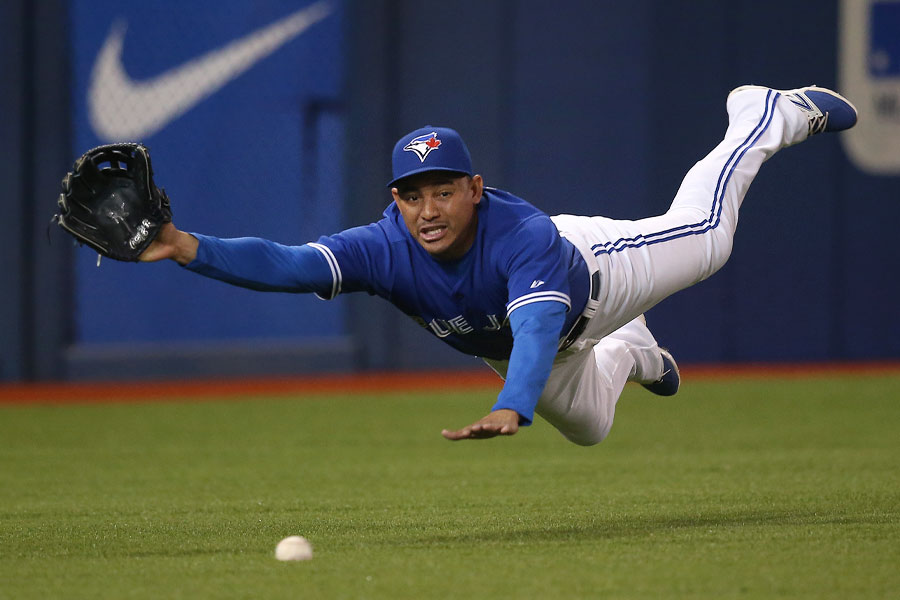 Ezequiel Carrera makes valiant effort as he traps a ball hit by Rougned Odor holding him to a single