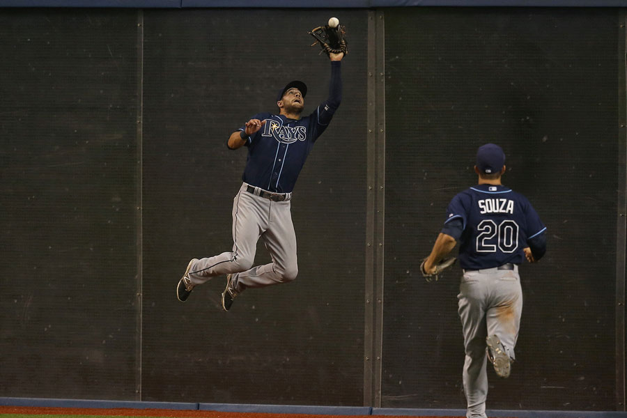 Kevin Kiermaier goes up to make a leaping catch against the wall