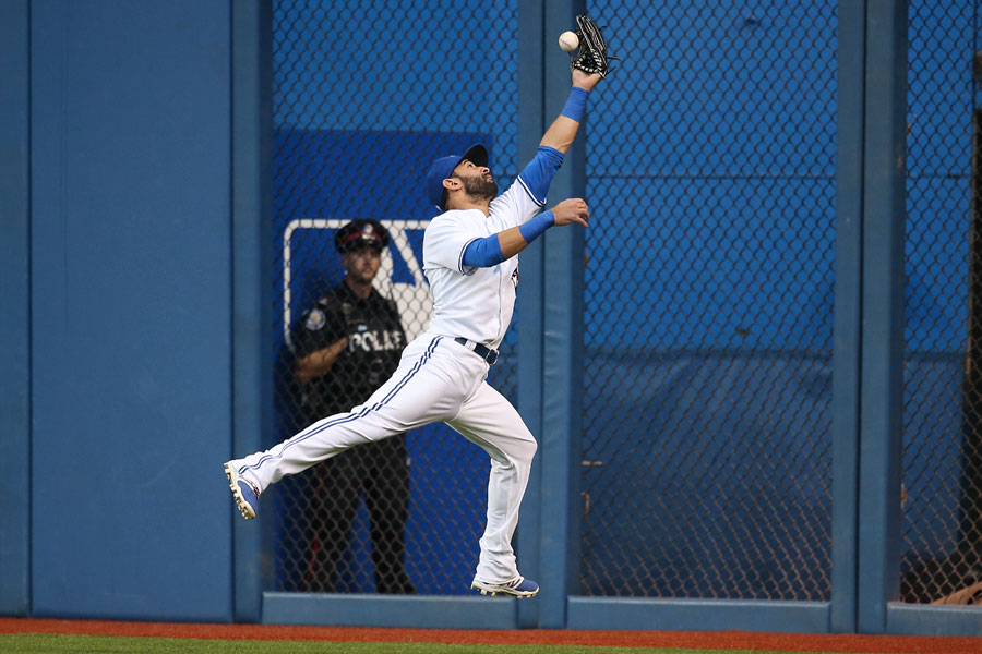 Jose Bautista jumps but can?t hold on to the ball as he closes in on the wall allowing an RBI double by Ryan Flaherty