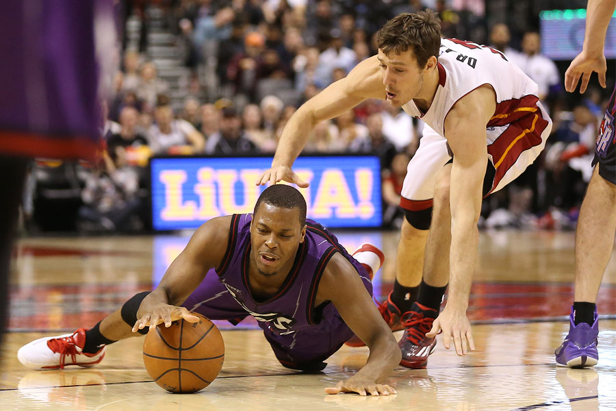 Kyle Lowry falls as he gets to a loose ball ahead of Goran Dragic