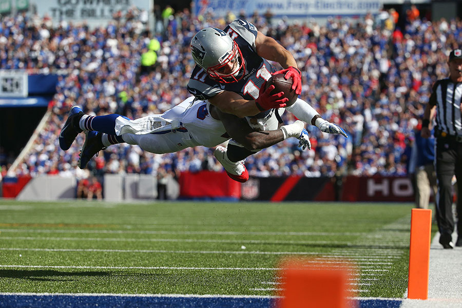 Julian Edelman dives into the end zone eluding the outstretched Aaron Williams to score a touchdown. This, by the way, is my favorite shot of 2015
