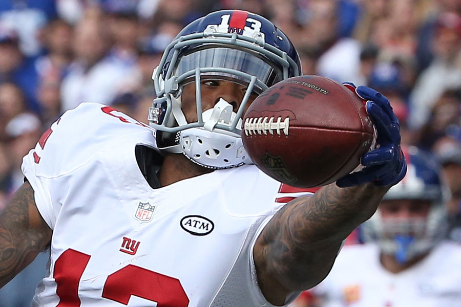 Odell Beckham Jr. reaches and manages to get the fingertips of his left hand on the ball but cannot snare it mere inches short of the end zone, which would have been a sure touchdown had he found a way to hold on