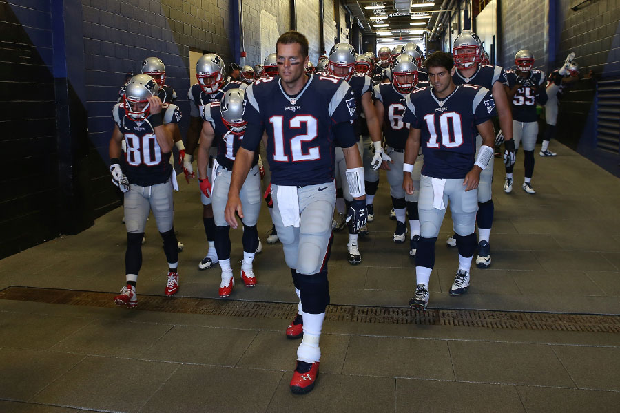 Tom Brady leads his team onto the field for their Week 2 game at Ralph Wilson Stadium against the Bills