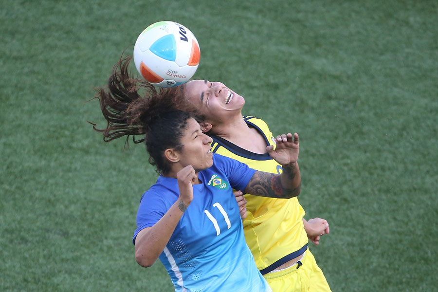 Brazil forward Cristiane Rozeira heads the ball against Colombia defender Orianica Velasquez during the gold medal match in women?s soccer at the 2015 Pan Am Games held at Hamilton Pan Am Soccer Stadium