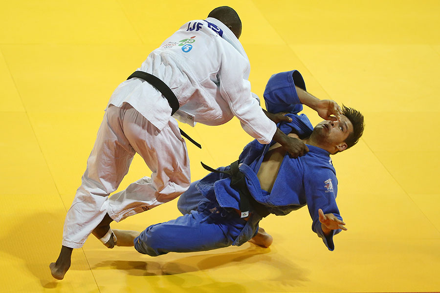 Juan Turcios (ESA) takes down Pedro Castro (COL) in the men?s 81kg judo competition during the 2015 Pan Am Games at Mississauga Sports Centre