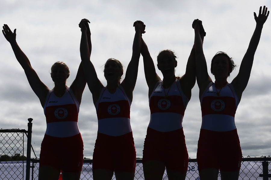 The Canadian women celebrate on the medal podium after winning the gold medal in the women?s quadruple sculls during the 2015 Pan Am Games at Royal Canadian Henley Rowing Course in St. Catharines