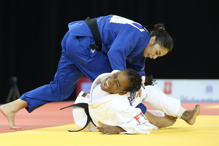 Mariana Silva (BRA) takes down Diana Velasco (COL) in the bronze medal match in the women?s 63kg judo competition during the 2015 Pan Am Games at Mississauga Sports Centre