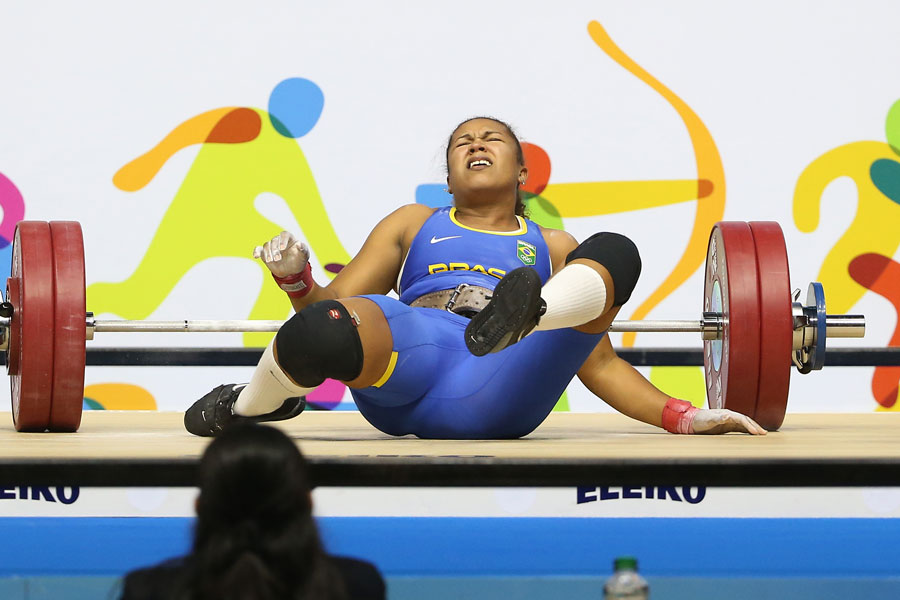 Jaqueline Antonia Ferreira (BRA) falls after dropping the weight in the women?s 75kg weightlifting competition during the 2015 Pan Am Games at Oshawa Sports Centre