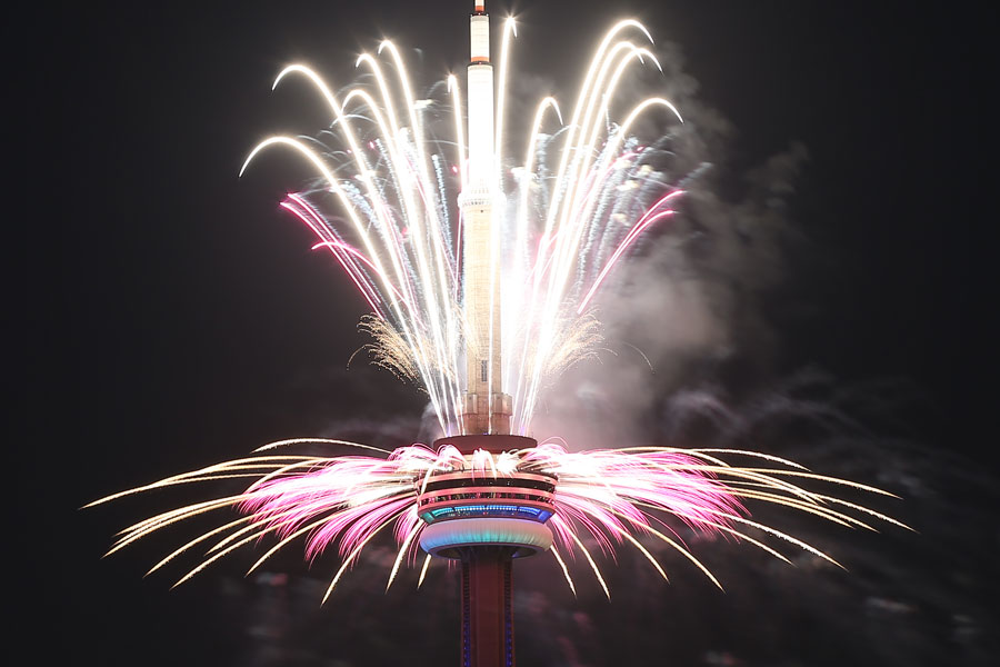 Fireworks shoot out of the CN Tower to mark the conclusion of the Pan Am Games at the end of the closing ceremonies