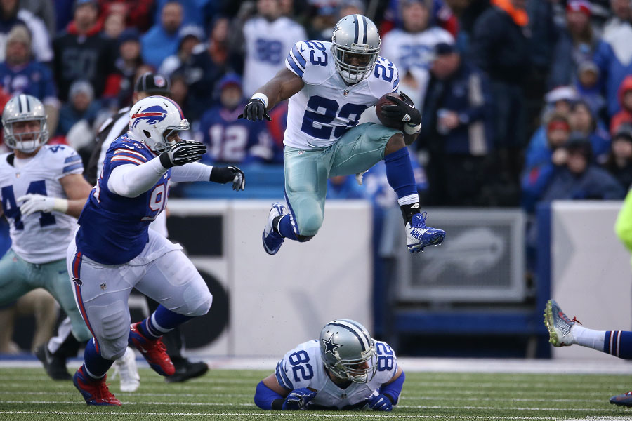 Robert Turbin jumps over his own teammate, Jason Witten